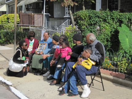 "A PMBC ""Clean Block Contest"" judge chats with the Elders of the community, some of the block's longest residents"