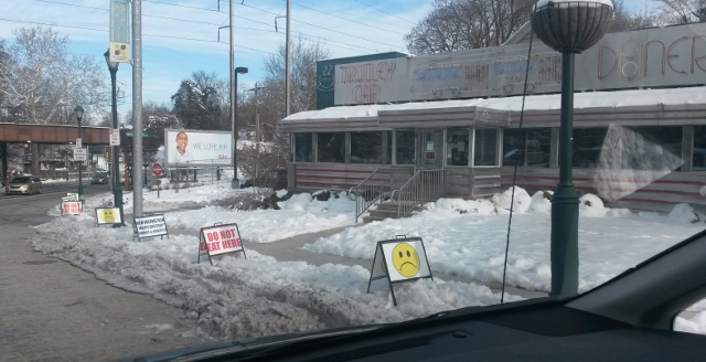 Union protest signs outside of The Trolley Car Diner in Mt. Airy (Photo via Chestnut Hill Local)