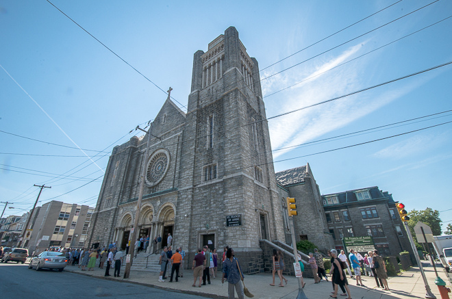 In 2012, congregants attend the final Mass at St. Francis of Assisi, which sits in-between Logan St and W Rockland St, across from the vacant lot. Photo by Theresa Stigale.
