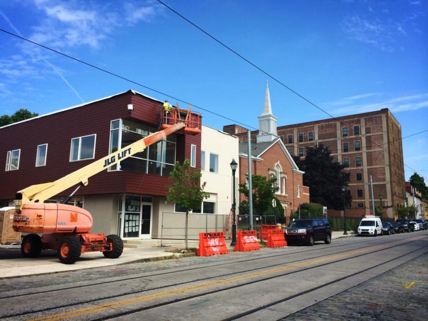 Looking towards Penn St on the 5300 block of Germantown Ave. From left-to-right, new construction in progress, Holsey Temple Church, and the renovation of 5301 Germantown Ave.