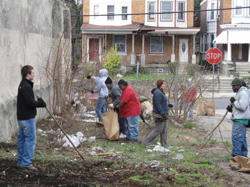 In 2009, residents on W Rockland St began organizing cleanups of the lot and the abandoned properties, working to maintain the area and put an end to illegal dumping.  Philly Spring Cleanup, April 4, 2009.