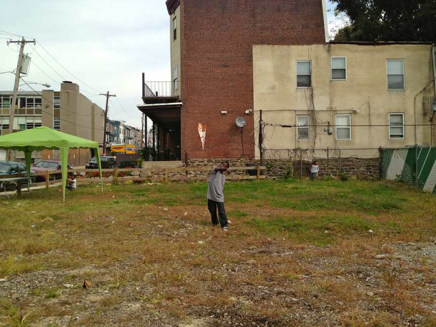 Kevon flies a paper airplane in October 2013 in front of 74 W Rockland St, where the mural will be installed.